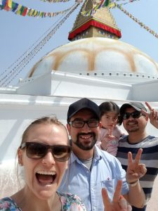 Me and my colleague (holding his daughter) and his brother having a selfie in front of Boudha stupa