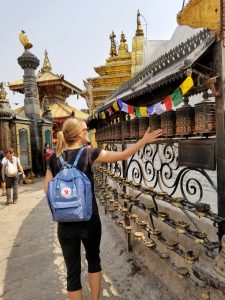 Me spinning the prayer wheels at the Monkey Temple